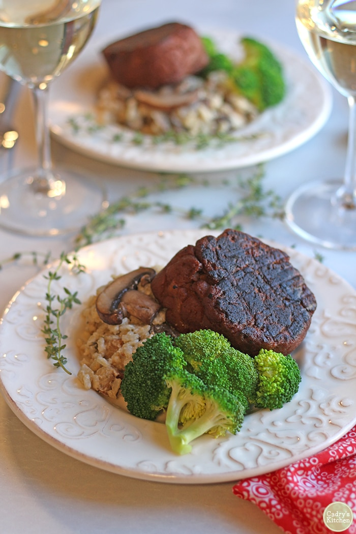 Vegan risotto on plate with steamed broccoli and Herbivorous Butcher filet.