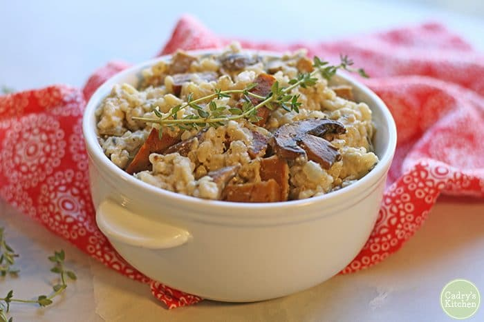 Vegan risotto with mushrooms and seitan sausage.