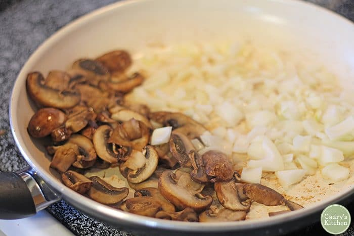 Sauteed mushrooms, onions, and garlic in skillet.