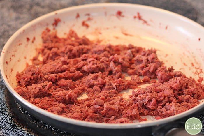 Vegan corned beef in skillet.
