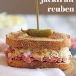 Text overlay: Vegan jackfruit reuben. Jackfruit sandwich on board with napkin.