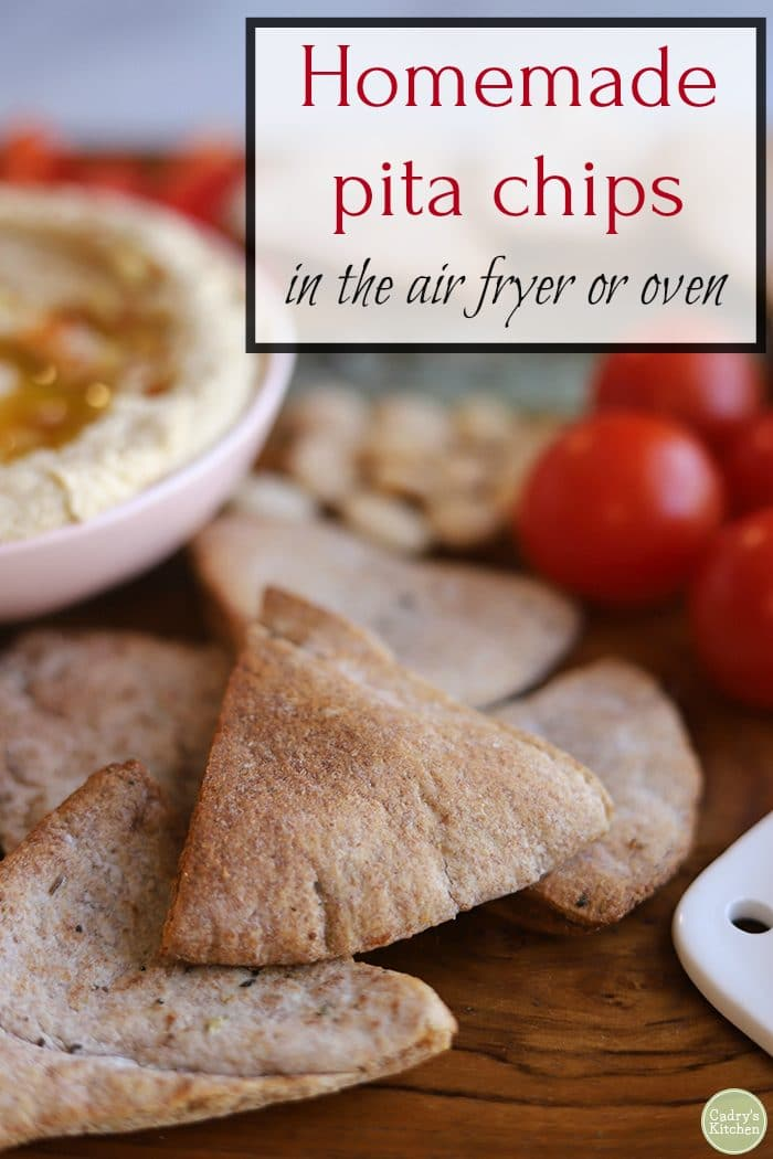 Text: Homemade pita chips in the air fryer or oven. Close-up pita chips on platter with hummus.