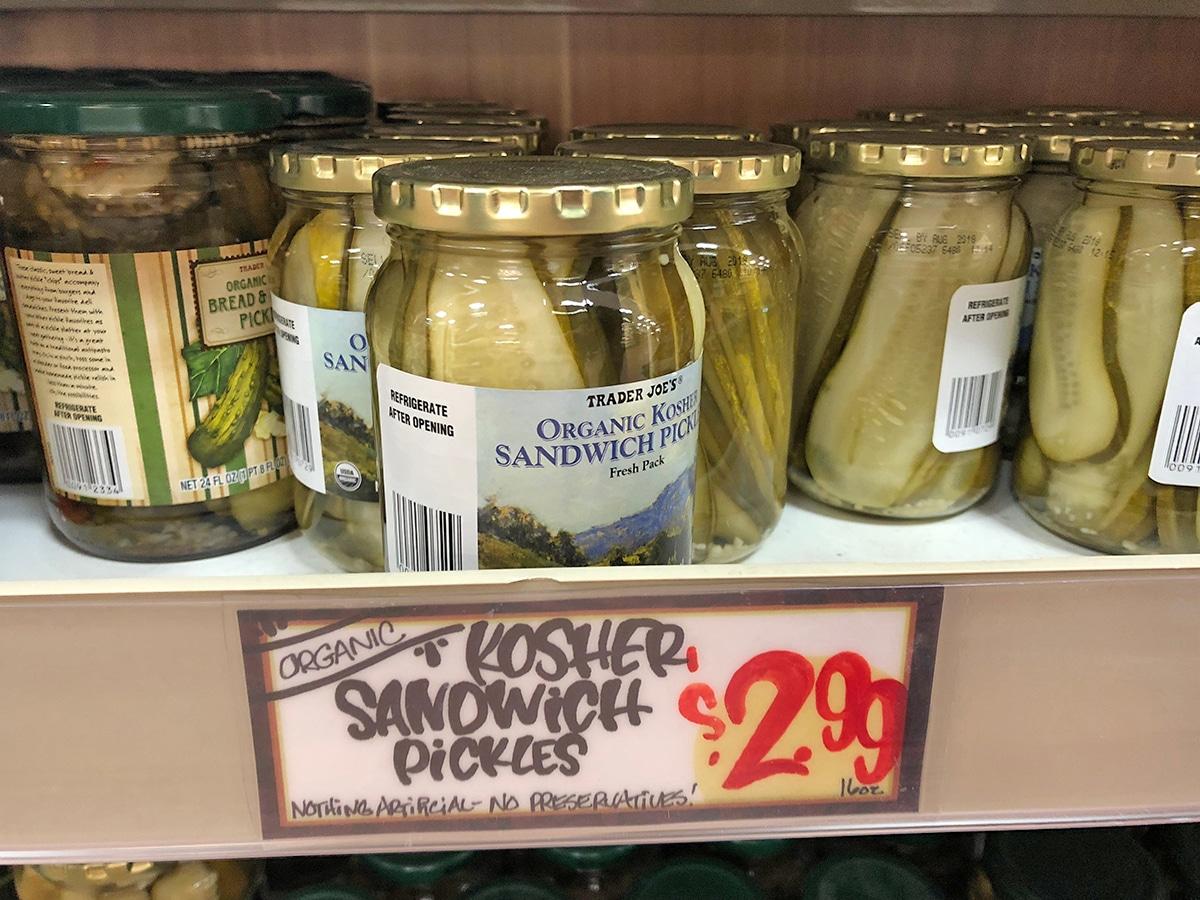 Jars of sandwich pickles on shelf.