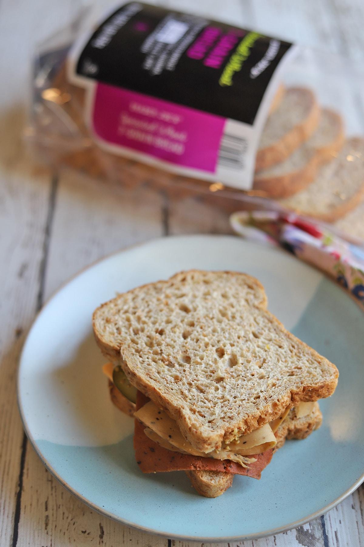 Sandwich by bag of bread.