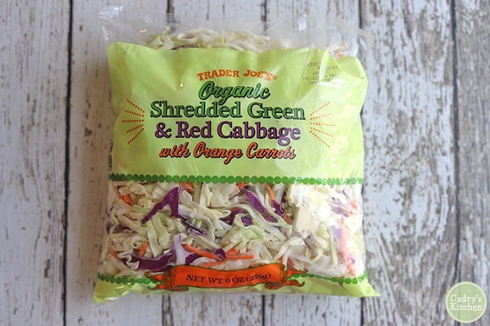 Bag of Trader Joe's organic shredded green and red cabbage.