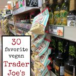 Text: 30 favorite vegan Trader Joe's products. Nutritional yeast flakes hanging on Trader Joe's shelf.