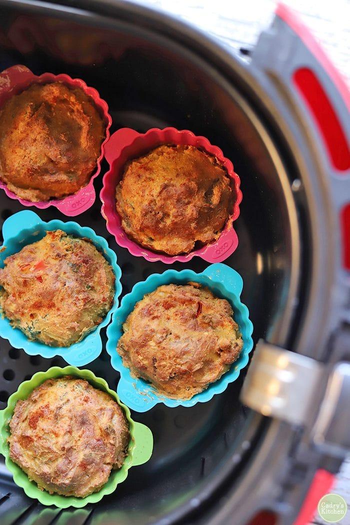 Mini vegan quiche in air fryer basket.