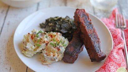 Seitan ribs from Herbivorous Butcher plus potato salad and collard greens.