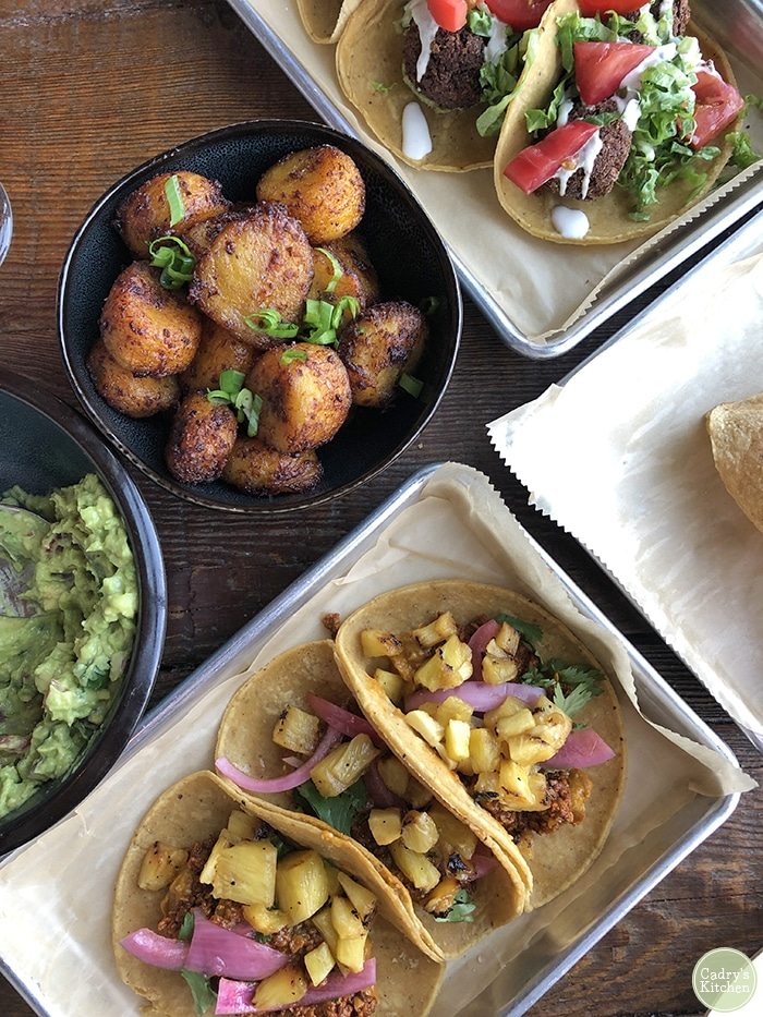 Overhead tacos and plantains on table at Caucho in Cedar Rapids.