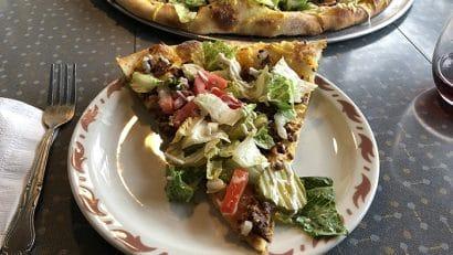 Slice of cheeseburger pizza at Cappy's in Cedar Rapids, Iowa.