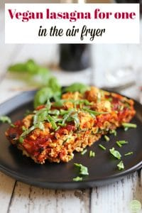 Text: Vegan lasagna in the air fryer. Slice of lasagna on plate.