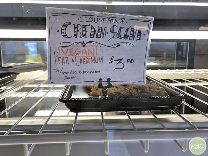 Sign for vegan scone in refrigerated case at Dodge Street Coffeehouse.