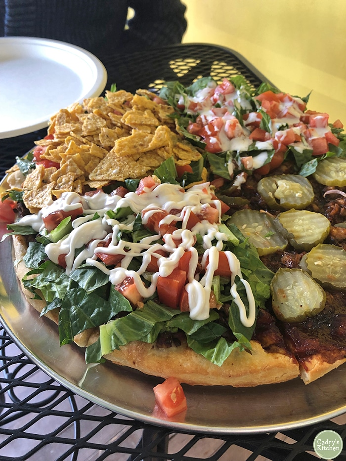 Pizza with 4 different kinds of toppings - including taco, BLT, and barbecue. A tasty vegan Quad Cities option.