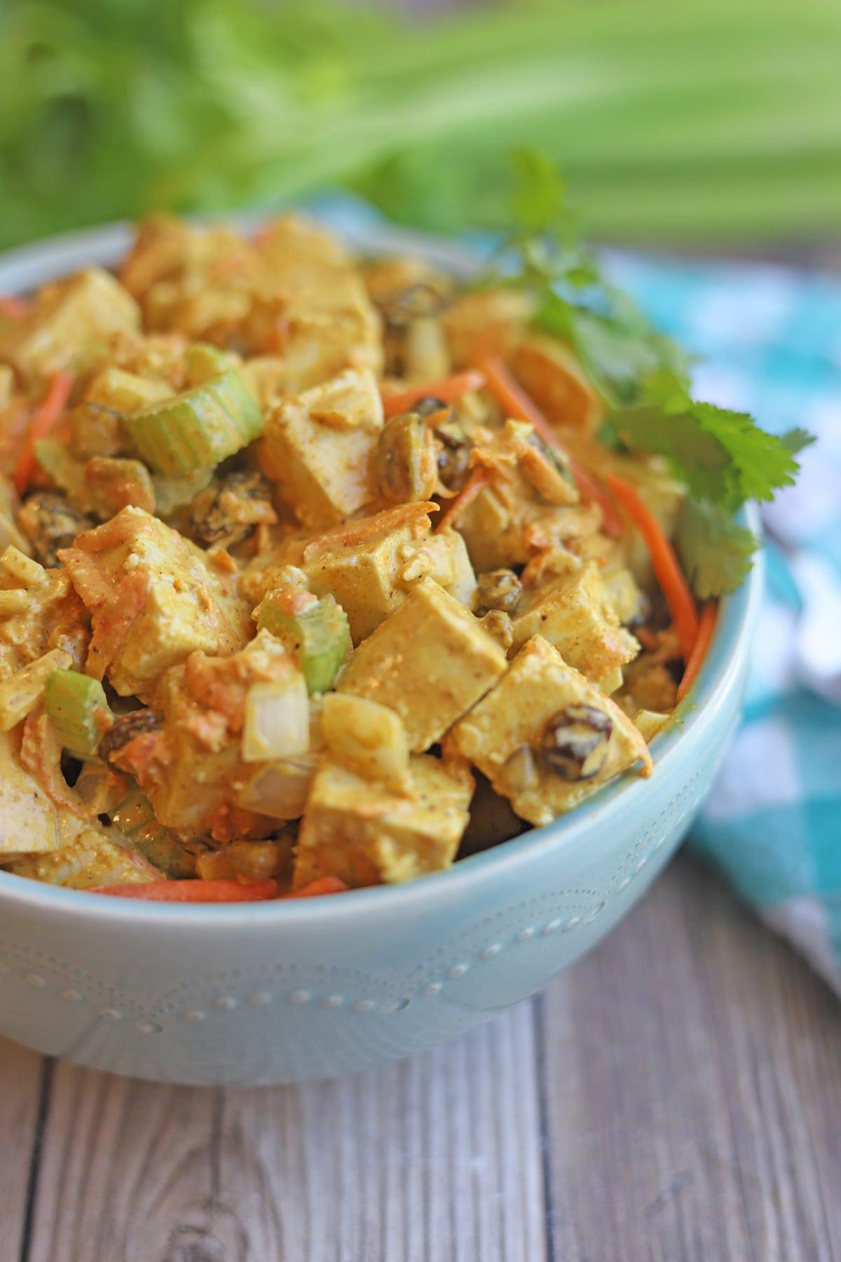 Close-up bowl of curry tofu salad.