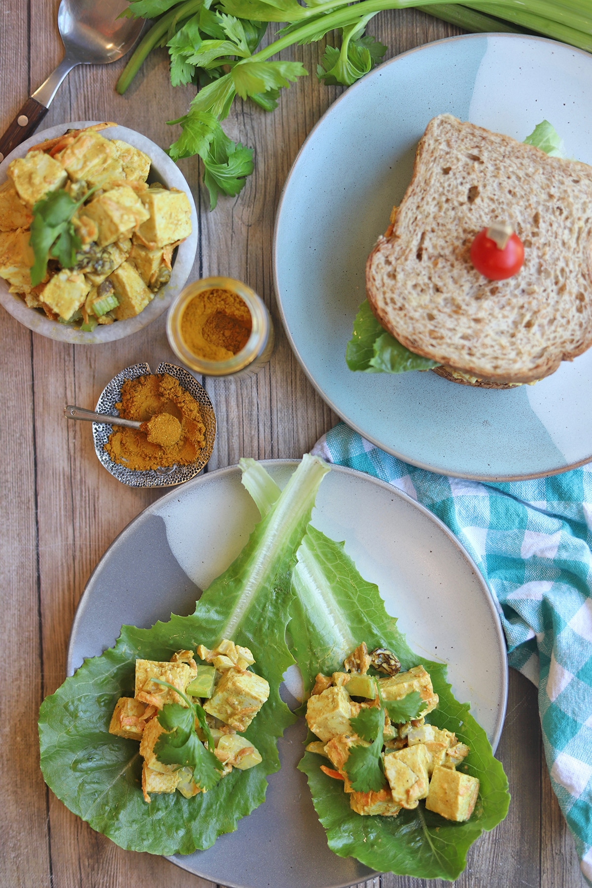 Overhead table with lettuce wraps and sandwich.
