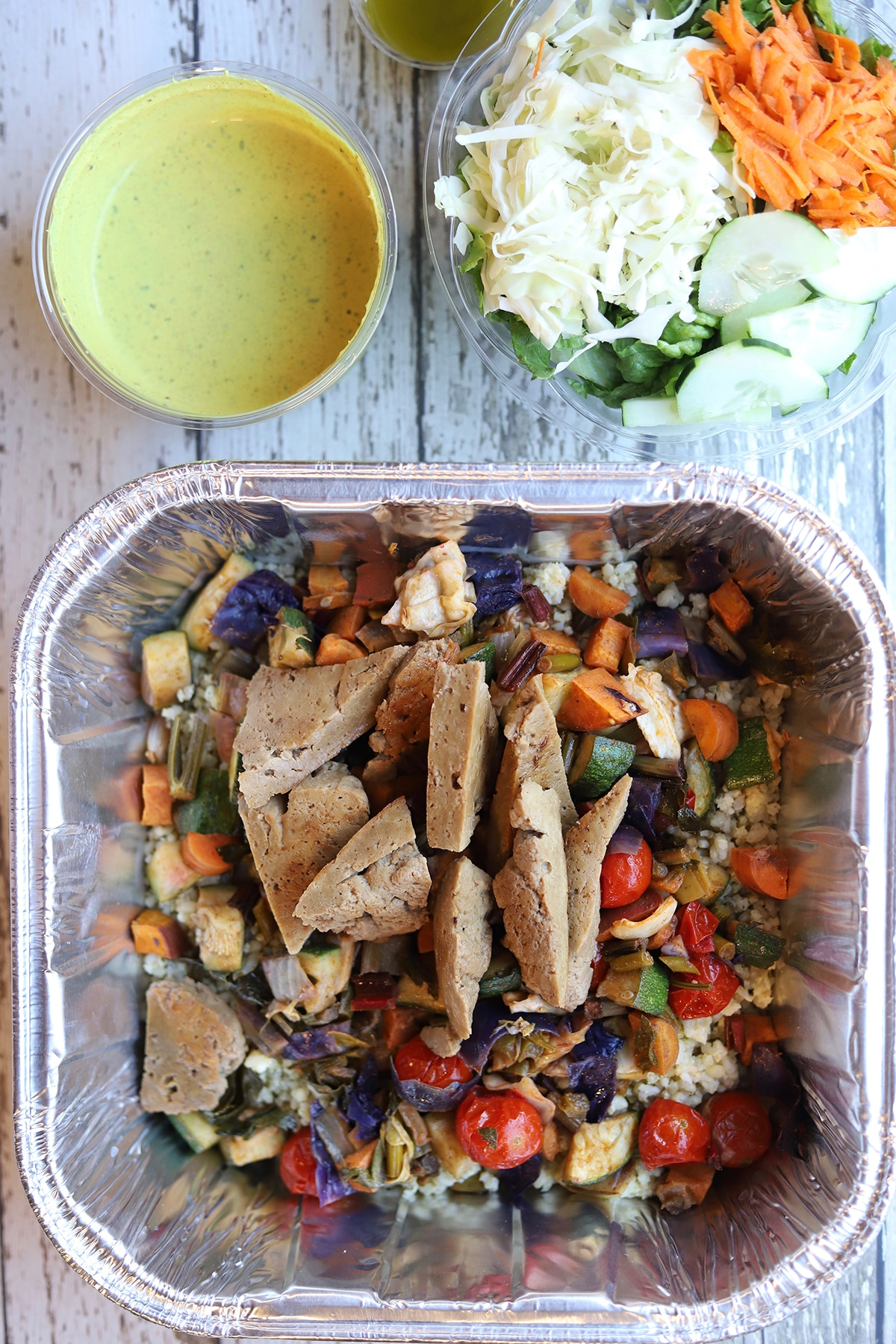 Overhead Trumpet Blossom take and bake meal - seitan with roasted vegetables.