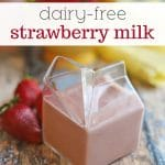 Text overlay: dairy-free strawberry milk. Old school glass container with pink strawberry milk.
