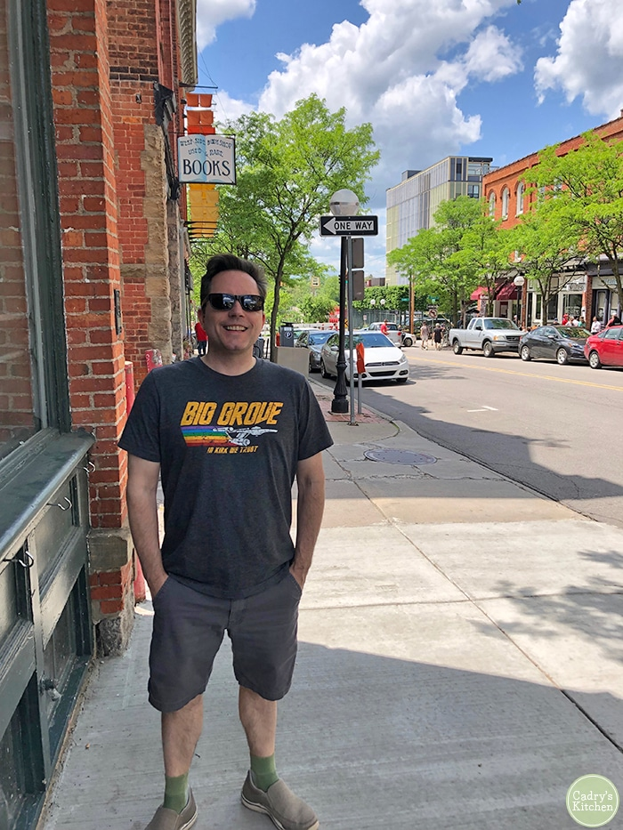 David standing in Ann Arbor, Michigan in front of a bookstore.