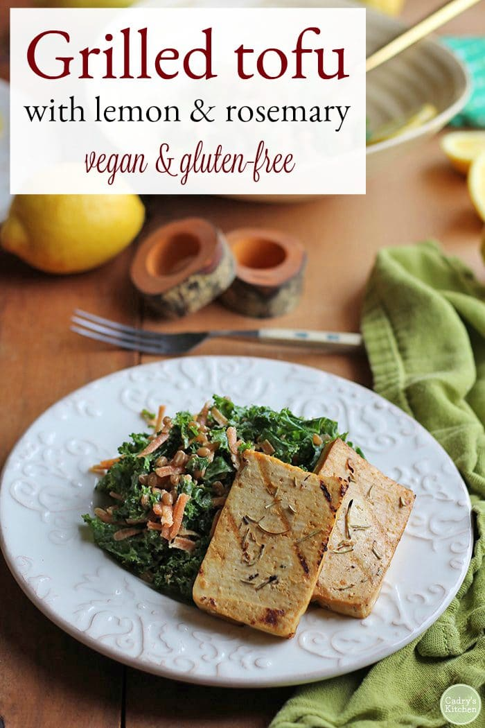 Text: Grilled tofu with lemon & rosemary. Vegan & gluten free. Tofu slices on bed of kale salad.