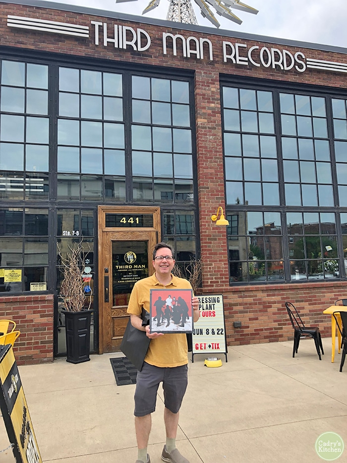 David holding a record outside of Third Man Records in Detroit.