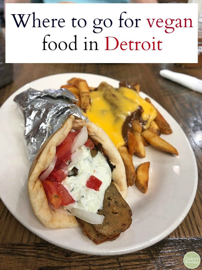 Text: Where to go for vegan food in Detroit. Gyro & chili cheese fries on plate.
