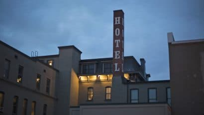 Exterior hotel with pole at Black Hawk Hotel in Cedar Falls, Iowa.