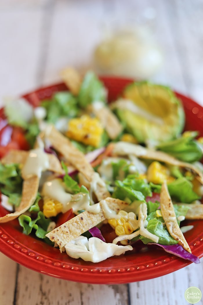 Southwest salad with creamy cashew salad dressing on top.