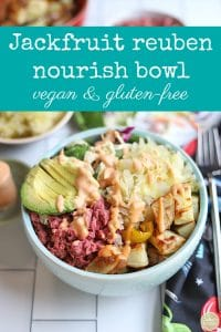 Text: Jackfruit reuben nourish bowl. Vegan & gluten-free. Bowl with jackfruit corned beef, sauerkraut, and avocado.