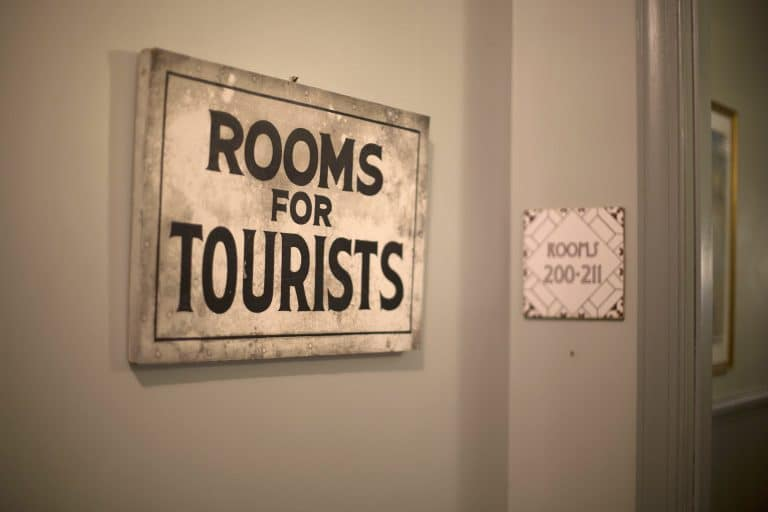 "Sign that says ""rooms for tourists"" at Black Hawk Hotel."