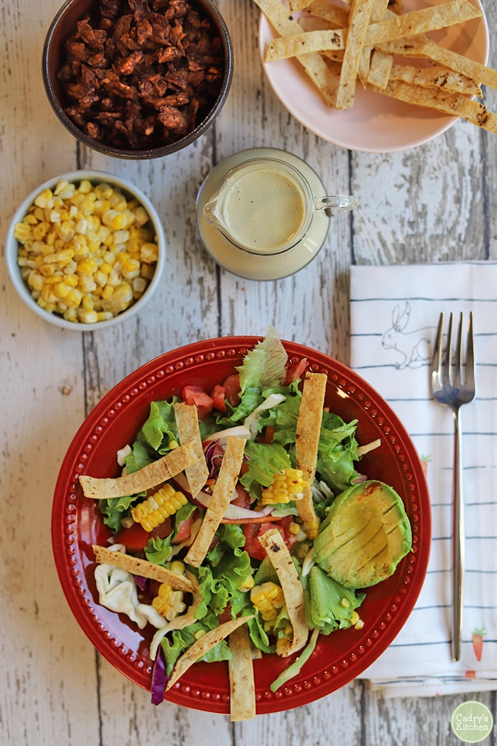 Overhead southwest salad with corn, cashew dressing, and avocado.