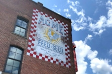 Exterior Acme building on Broadway in Nashville. Words say Acme Feed & Seed.