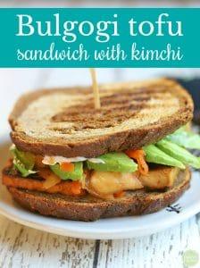 Text: Bulgogi tofu sandwich with kimchi. Sandwich on plate.