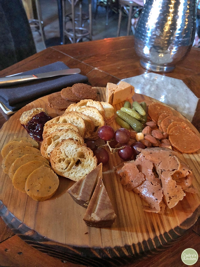 Charcuterie board with vegan meats & cheeses.