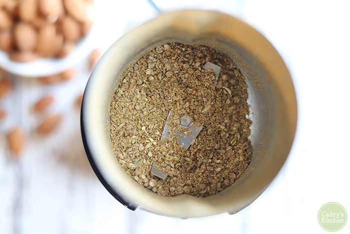 Coarsely ground spices in a coffee grinder.