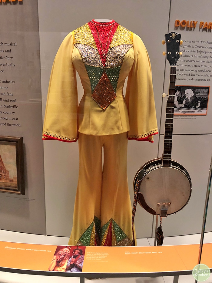 Dolly Parton's costume and banjo on display.