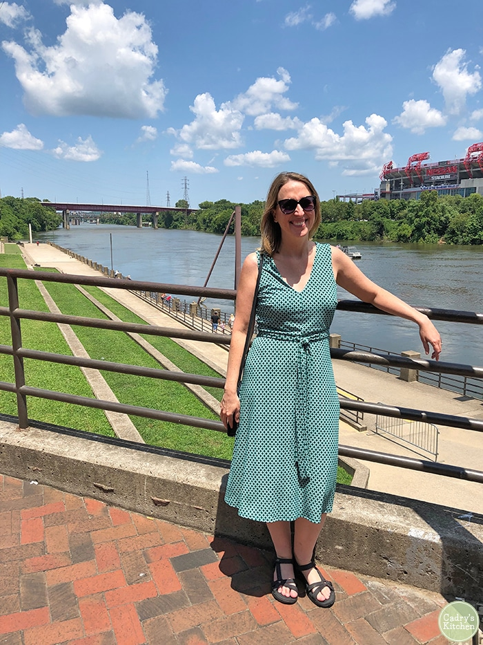 Cadry standing in front of the river in Nashville.