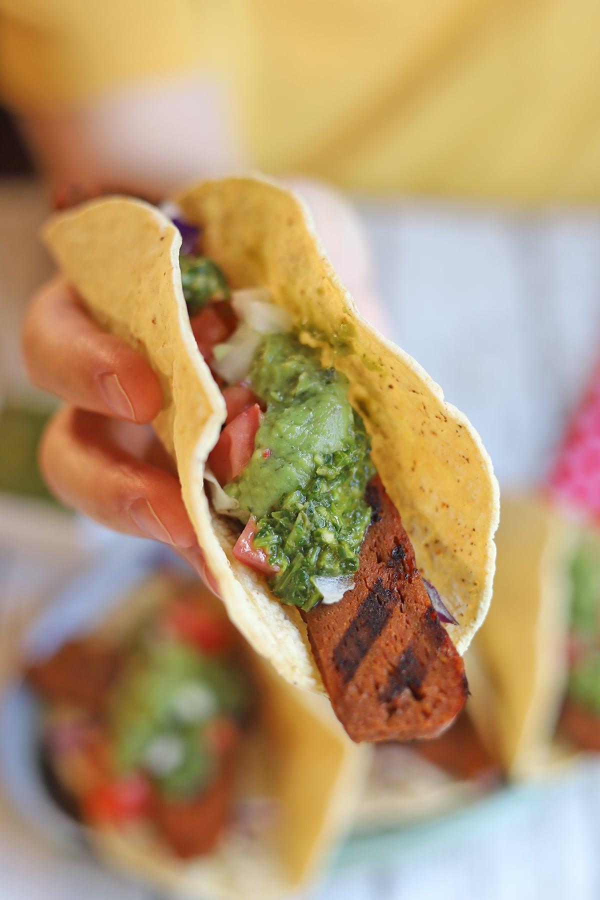 Hand holding taco.