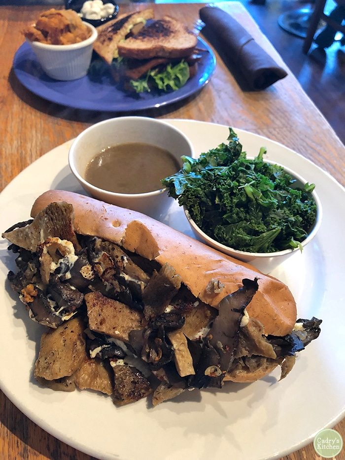 Vegan French dip sandwich and kale.