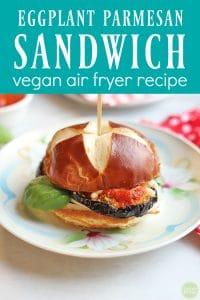 Text: Eggplant parmesan sandwich vegan air fryer recipe. Sandwich on plate.