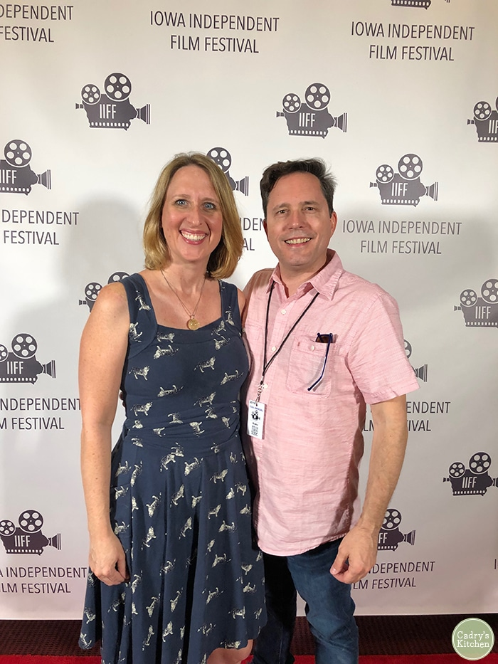 Cadry & David in front of a backdrop for the Iowa Independent Film Festival in Mason City Iowa..