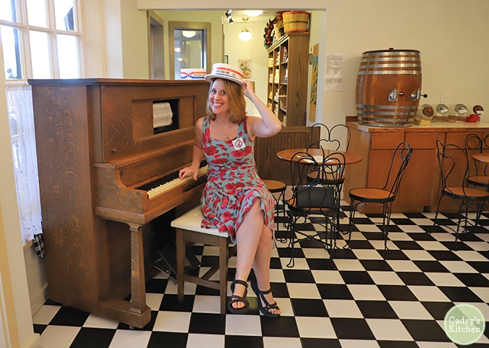 Cadry with a piano at the Music Man museum in Mason City, Iowa.