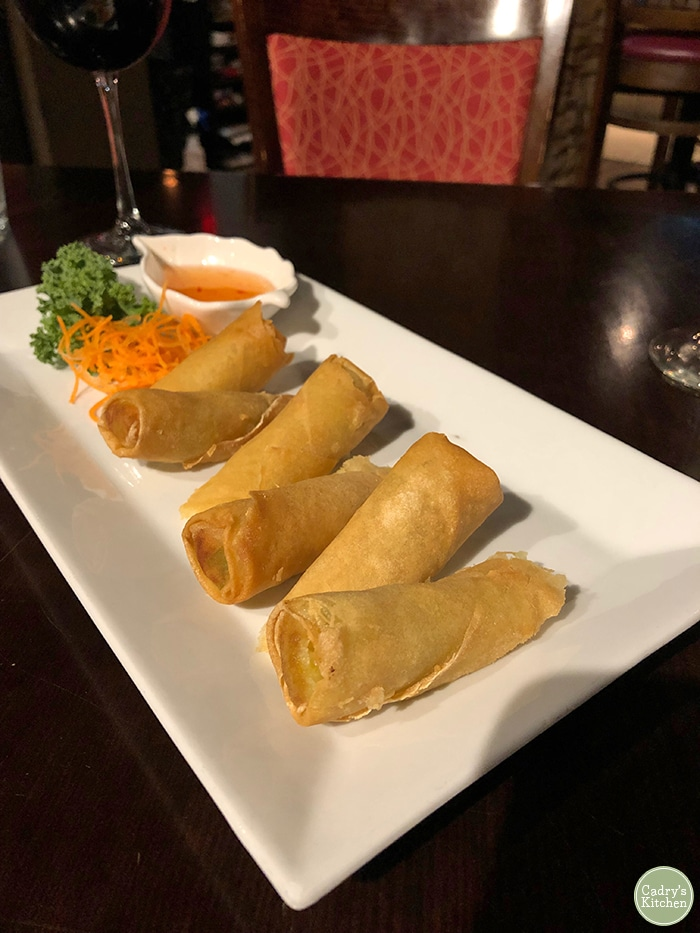 Fried spring rolls on plate.