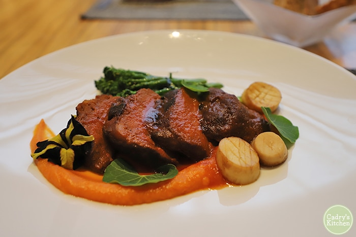 Seitan tenderloin, mushroom scallops, and sweet potato puree.