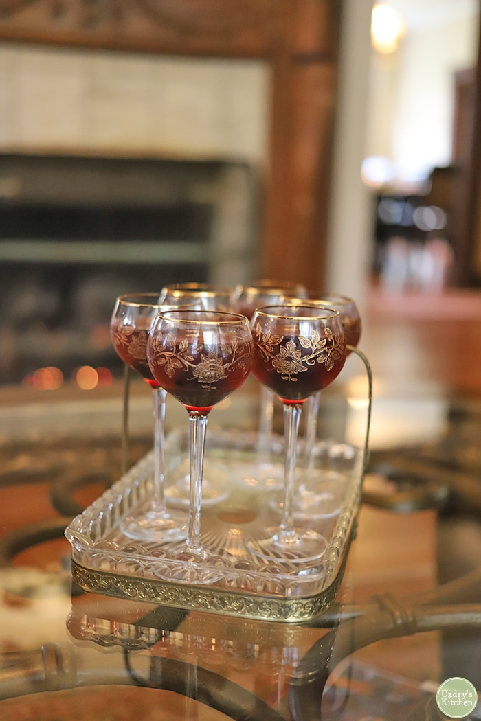 Cherry cordial cocktails in ornate glasses.
