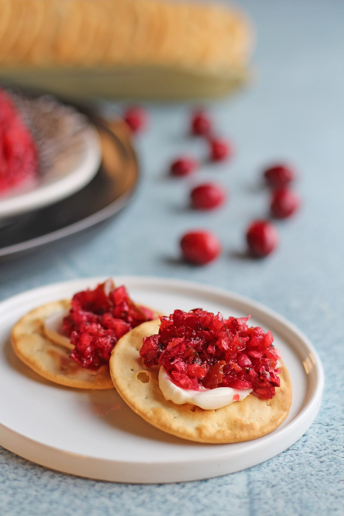 Crackers slathered with cranberry salsa and non-dairy cream cheese.