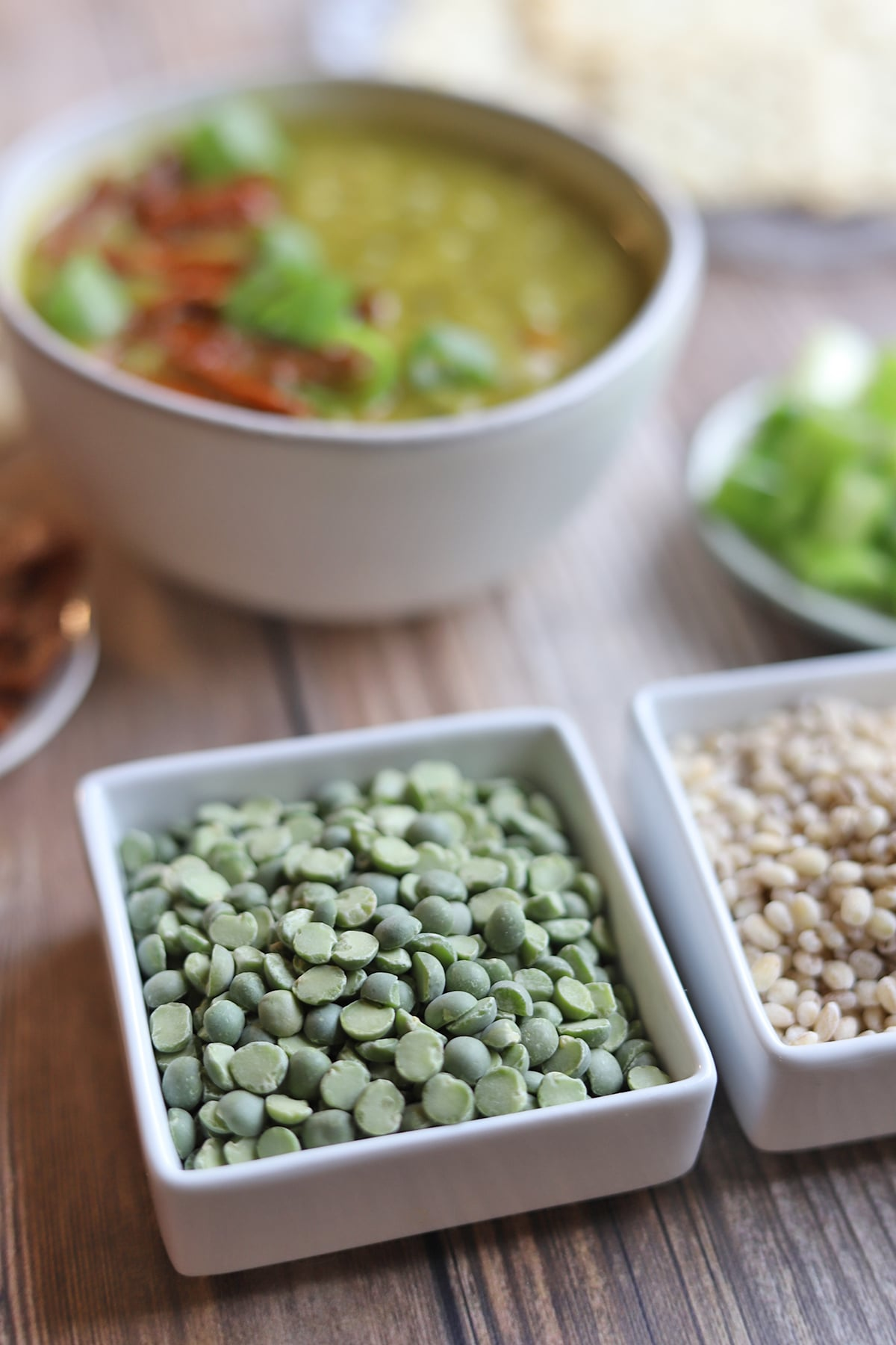 Dried split peas and barley in small bowls.