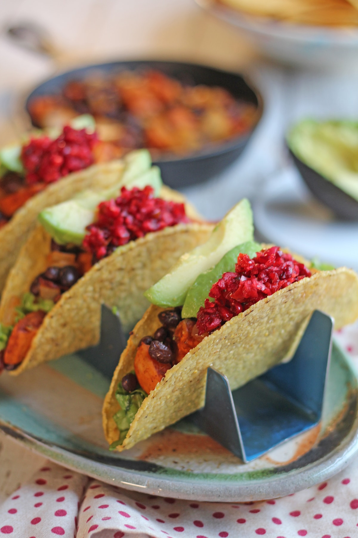 Sweet potato and black bean tacos topped with cranberry salsa.