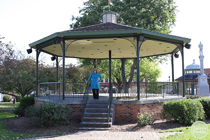 Cadry poses in front of gazebo in downtown Woodstock, Illinois.