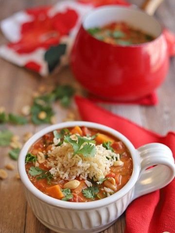 Sweet potato stew with rice in large mug by soup pot.