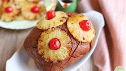 Vegan ham with pineapple slices, maraschino cherries, and pineapple brown sugar glaze.